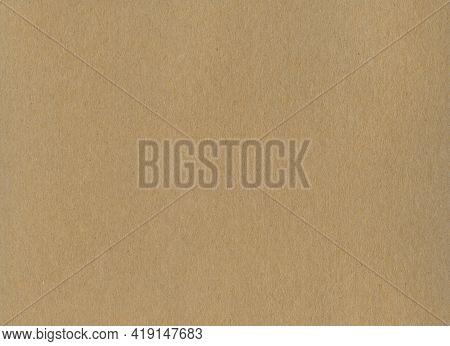 Clean Brown Kraft Cardboard Paper Background Texture. Vintage Cardboard Wallpaper