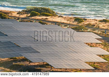 Solar Panels Installed Along The Coastline At Sunset In South Australia