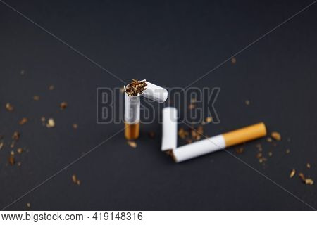 Breaking, Destroying Cigarettes, Smoking Tobacco Flat Lay On Black Grunge Texture Background. For An