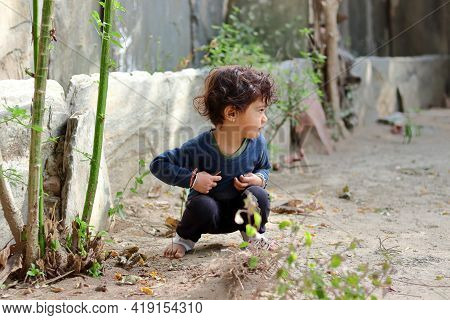 Closeup Of An Asian Little Baby Boy Child Playing In The Sand In The Yard.concept To Childhood, Beau