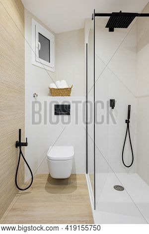 Interior Of Modern Style Bathroom In White And Beige Colors In Refurbished Apartment. Shower Zone An