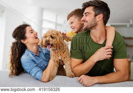 Happy Family. Beautiful Young Parents Having Fun, Playing With Their Son At Home.