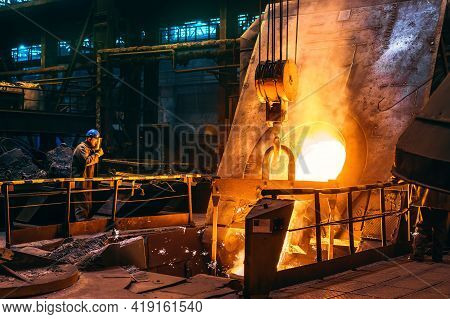 Molten Iron Pouring From Blast Furnace Into Ladle Container, Steel Foundry Factory, Heavy Metallurgy
