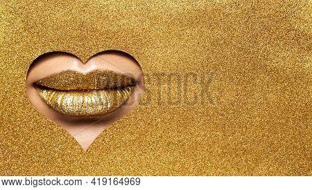 Golden Lips Make Up. Gold Beauty Woman Makeup Face. Gold Lipstick Close Peek Out Glitter Yellow Pape