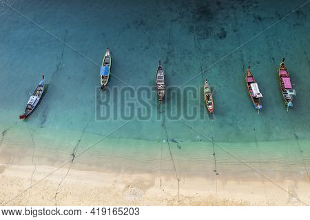 Aerial Drone Top Down View Of Fishing Boats In The Shore During Low Tide. Top View A Lot Of Thai Tra