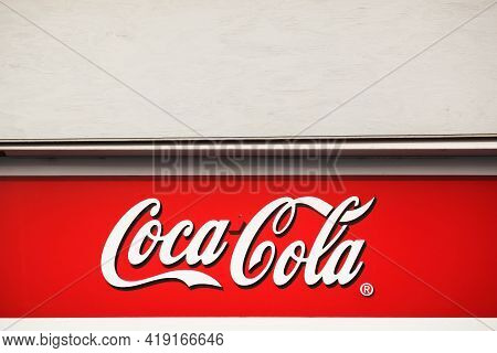 Hou, Denmark - March 28, 2014: Coca-cola Logo On A Building. Coca-cola Is A Carbonated Soft Drink. I