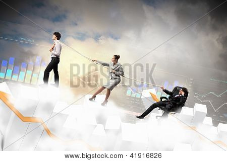 Image of three businesspeople with rope against diagram background