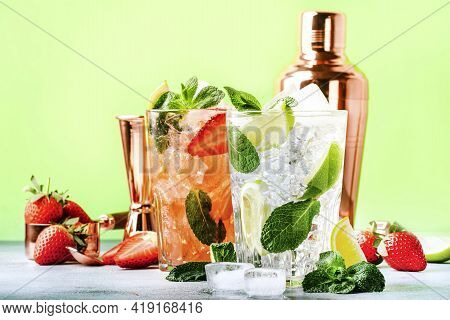 Summer Mojito Cocktail Or Mocktail Set With Lime, Mint, Strawberry And Ice In Glass On Green Backgro