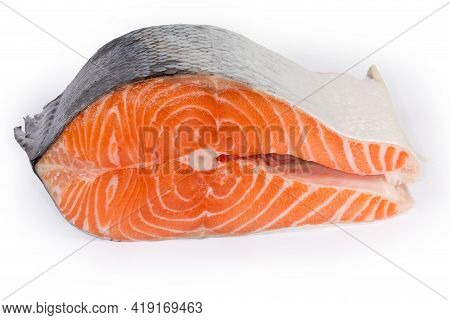 Piece Of Uncooked Chilled Salmon Cut Across On A White Background, Close-up In Selective Focus