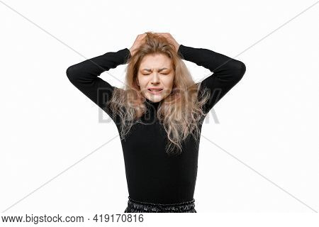 Portrait Of Concerned, Worried And Anxious Young Woman Wearing Casual Black Clothes Grab Head And Pa