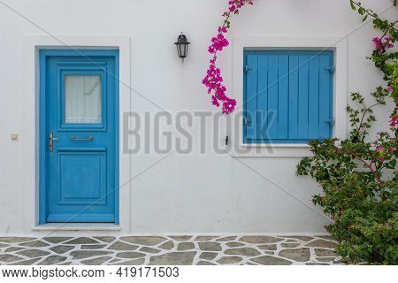 View Of The White Villas At Popular Resort In Antiparos Island. Blue Door And Shutter.cyclades Archi