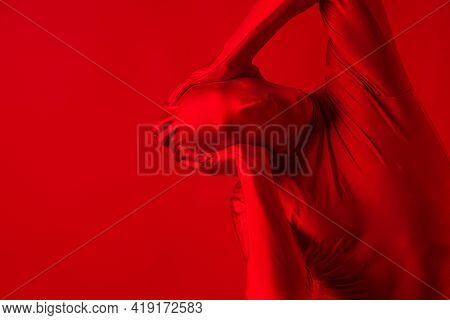 Crazy Screaming Red Man On A Red Background. Figure In A Leotard