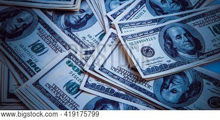 Cash Of Hundred Dollar Bills, Dollar Background Image. One Hundred Us Banknotes Are Scattered Over T