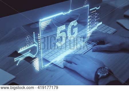 5g Network Concept With Hologram Screen With 5g Inscription Over Man Hands Typing On White Keyboard
