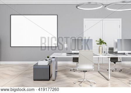 Bright Empty Office Room With A White Empty Banner On The Wall, Wooden Floor And Concrete Wall, Inte