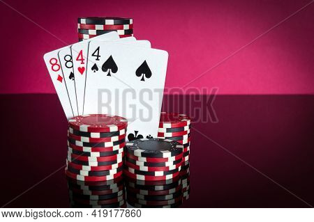 Poker Cards With Two Pairs Combination. Close-up Of Playing Cards And Chips In Poker Club. Free Adve