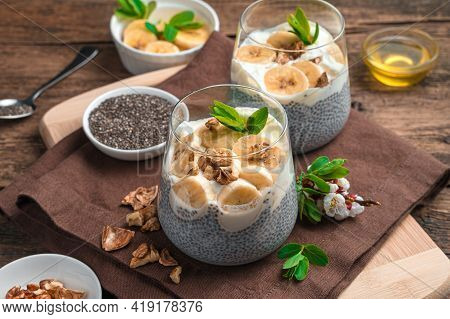 Chia Seed Pudding With Cream, Banana, Nuts And Honey. Natural Healthy Dessert.