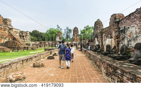 Ayutthaya, Thailand - May 12,2018 : Unidentified Tourists Walking In Wat Mahathat In Ayutthaya Histo