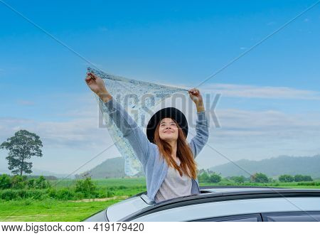 Asian Woman Standing Out Of Car Sunroof. Relaxing And Freedom With Spring Time. Young Tourist Travel