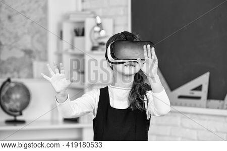 Schoolchild Using Virtual Reality. Virtual Reality Headset. Teenage Schoolgirl In Classroom. Back To