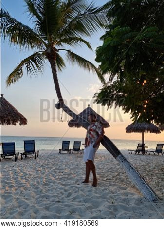 Palm Beach Aruba Caribbean, White Long Sandy Beach With Palm Trees At Aruba Antilles, Young Man Mid