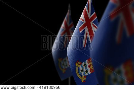 Small National Flags Of The Cayman Islands On A Black Background