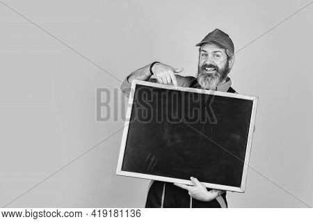 Advertisement. Builder Points To Board. Architect Worker Hold Blackboard. Conference Meeting. Person