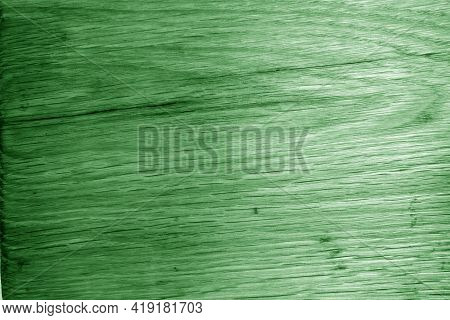 Old Oak Board Texture As Background With Blur Effect In Green Tone. Surface And Natural Pattern.