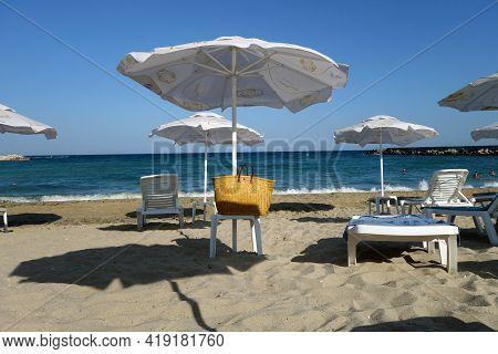 Beach Umbrellas And Black Sea View. Seasonal Natural Background.