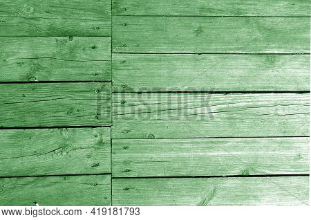 Wall Made Of Uncutted Weathered Wood Boards In Green Tone. Abstract Architectural Background And Tex