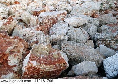Stones Used As Breakwater At The Sea. Sea View And Background.