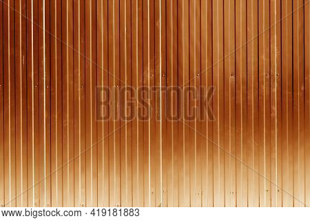 Metal Sheet Fence Texture In Orange Color. Architectural And Construction Background