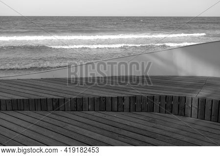 Wooden Pier Boardwalk And Sea View In Black And White. Seasonal Natural Background.