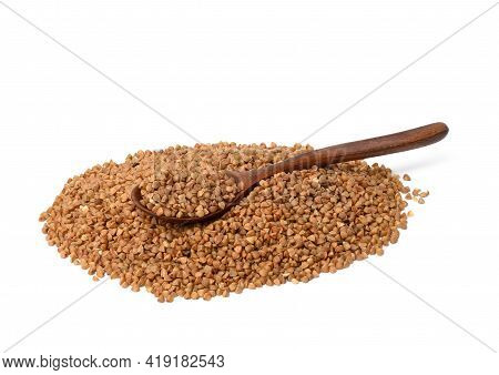 Raw Buckwheat Grains In Wooden Spoon Isolated On White Background, Close Up