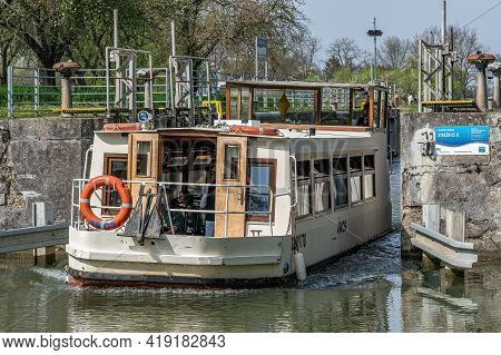 Straznice, Czech Republic - May 1, 2021, Lock Chambers On The Waterway Bata Canal. Passing Ship. Nat