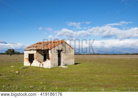 Abandoned and ruined house in the countryside. Stunning clouds in the sky