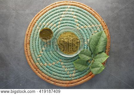 The Wooden Bowl With Rehydrated Henna On Table