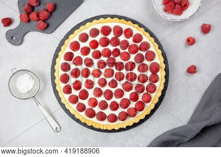Delicious Raspberry Tart With Whipped Cream And Mascarpone On A Light Gray Concrete Background. Top
