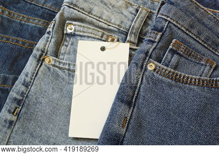 White Label For Mock Up On A Jeans Clothes Background