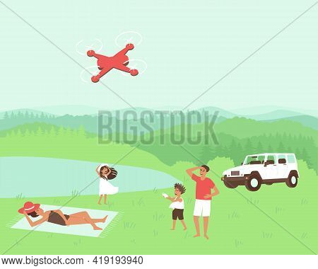The Family Is Resting In Nature In Solitude. Travelling By Car. Dad And Son Are Launching A Quadcopt