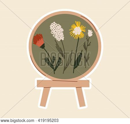 Sticker With Beautiful Sewing Artwork With Flowers On Wooden Stand. Concept Of Sewing Or Needlework