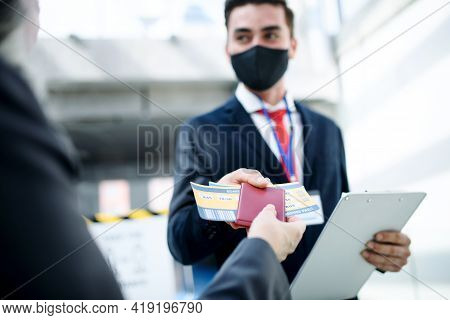 Senior Woman With Boarding Pass At The Gate In Airport, Coronavirus, Travel, And New Normal.