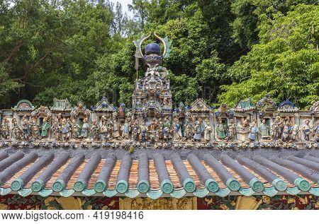 Historical Sculpture On The Rooftop Of Kwan Tai Temple In Fishing Village Tai O In Hong Kong