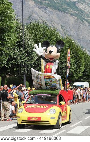 Saint Jean De Maurienne, France - July 24, 2015: Le Journal De Mickey Car During The Passing Of The