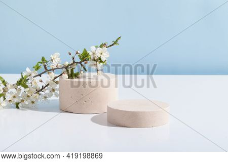 Empty Cylindrical Podium Or Plinth On A Blue White Background. Blank Shelf Product Standing Backgrou