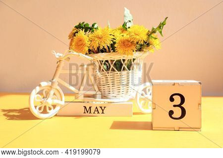 Calendar For May 3 : A Cube With The Number 3, The Name Of The Month Of May In English, A Bicycle Wi