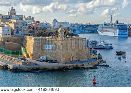 Valletta, Malta - March 25, 2021: The Grand Harbour Of Malta With Cruise Ship And Typical Old Archit