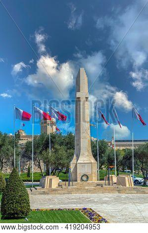 Valletta, Malta - March 25, 2021: Latin Cross Obelisk. War Memorial Commemorating The Dead Of World
