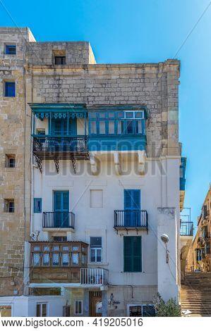 Valletta, Malta - March 25, 2021: Types Of Balconies, Specific To Malta. Minimalist Architecture.
