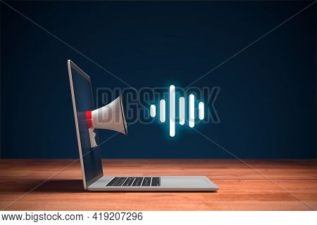 Podcast Or Music Listening Concept With Megaphone And Notebook. Computer On Wooden Table, Megaphone